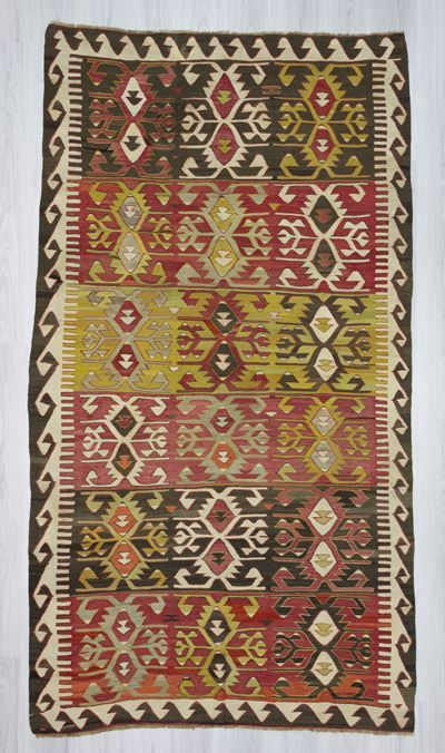 Vintage handwoven kilim rug from Konya region of Turkey. In very good condition. Approximately 45-55 years old. Wool on wool