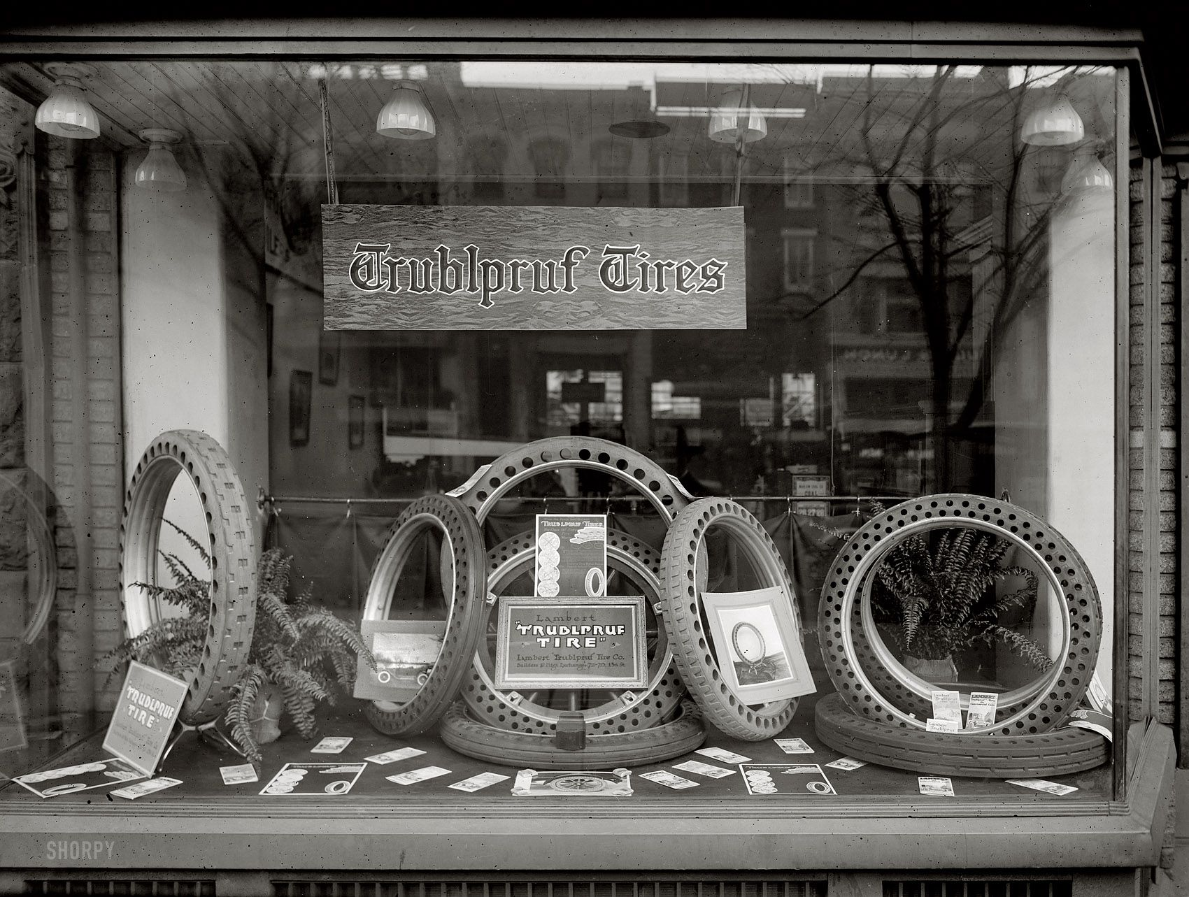 """Washington, D.C., circa 1920. """"Draper window."""" A display for Lambert Trublpruf solid rubber tires, a business owned by Charles W. Draper."""