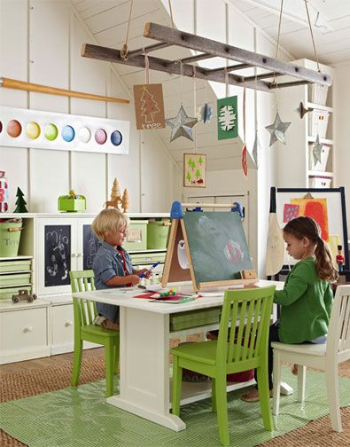 love the distressed ladder hanging from the ceiling! great way to display the kids' projects