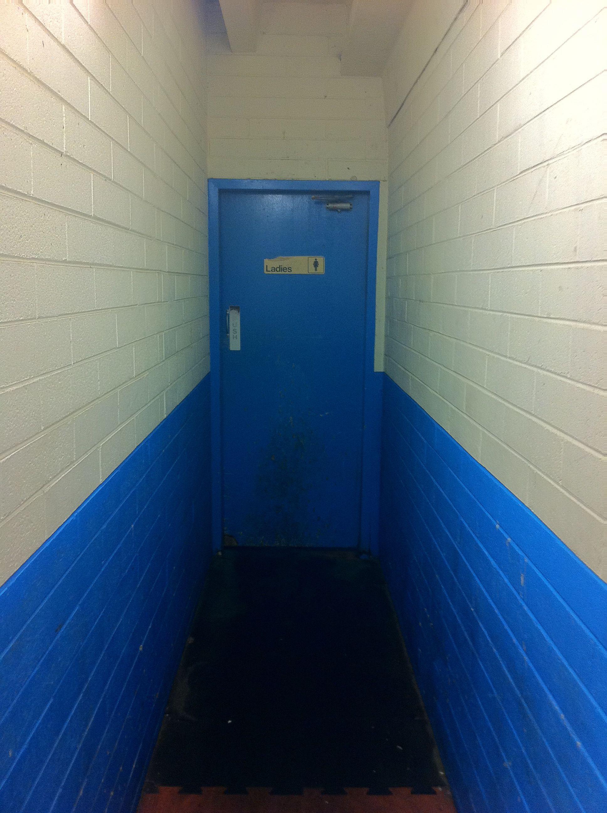 Hallway leading to the ladies rooms - Bathroom Hallway To Toilet But Black