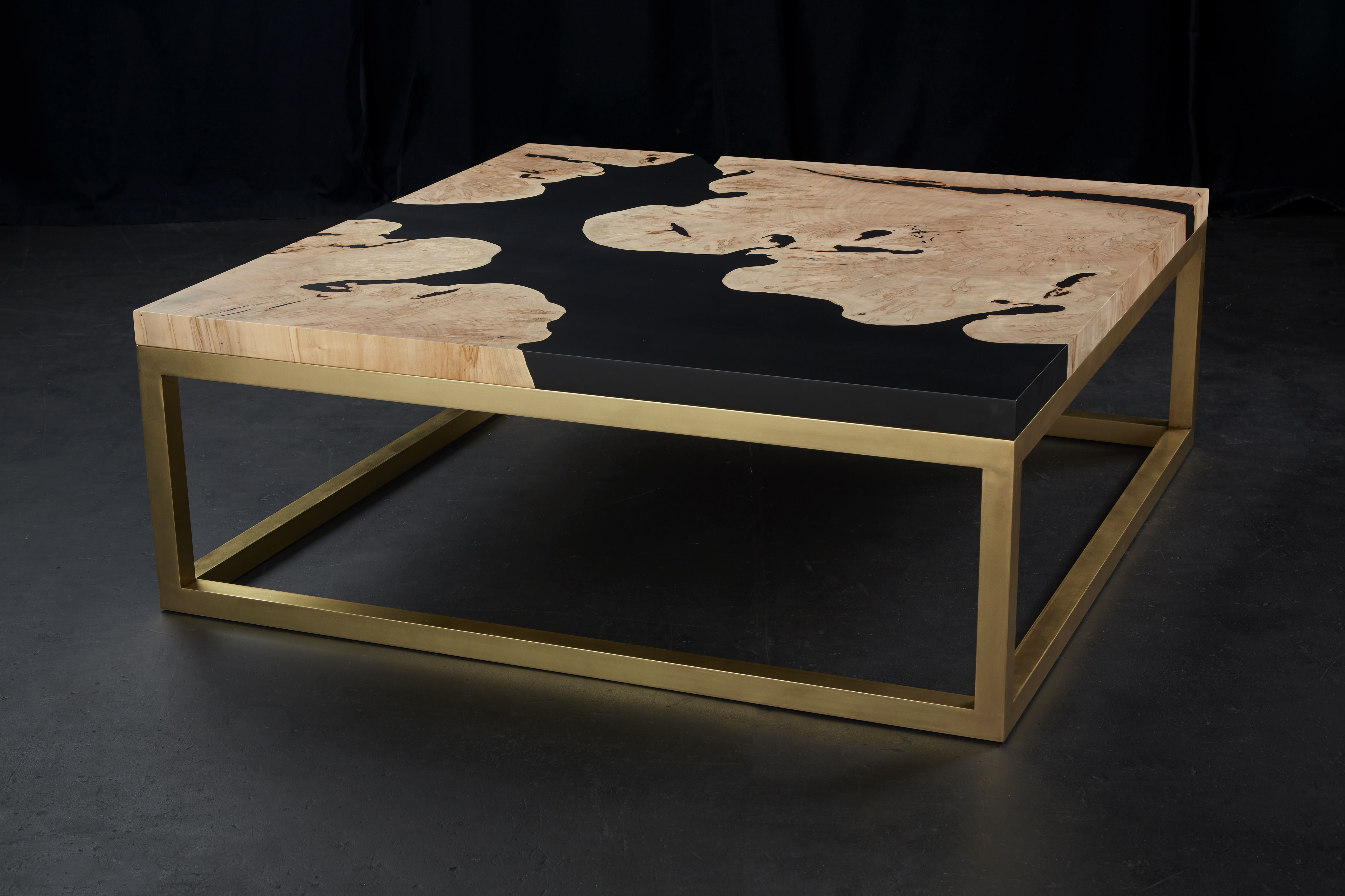 Coffee table made of soft maple wood and black-tinted epoxy resin