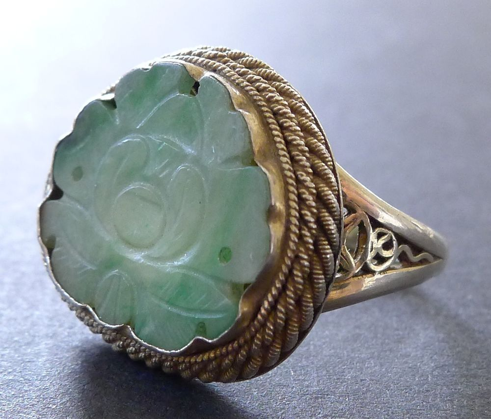 Antique Carved Jade Sterling Silver Filigree Ring. Unmarked Sterling Silver. The ring band is 3mm wide. This piece was acquired from a German antique jewelry collector. I describe all vintage and antique items to the best of my knowledge.