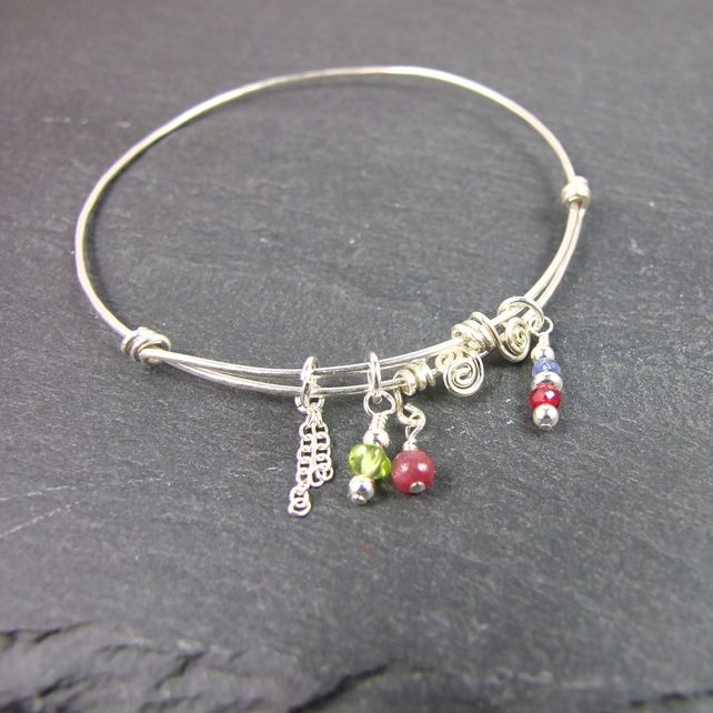 cd704de33 Sterling Silver Worry Bangle with Ruby, Tanzanite and Peridot, Free Size  £14.00