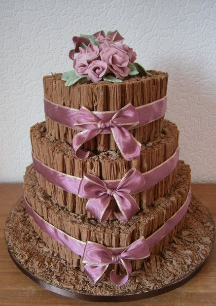 Chocolate Flake wedding cake - though for such a dark cake I would put white decorations/flowers/bows on it - even sprinkle icing sugar?