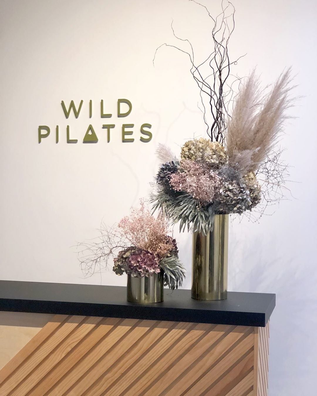 """Wild Pilates on Instagram: """"✨ We couldn't be happier with our new black benchtops from our friends at @evolutionofsurfaces and of course our lovely arrangements by…"""""""