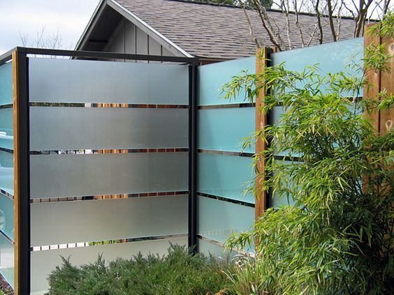 Frosted glass fence david wilson garden design repinned for Garden decking glass panels