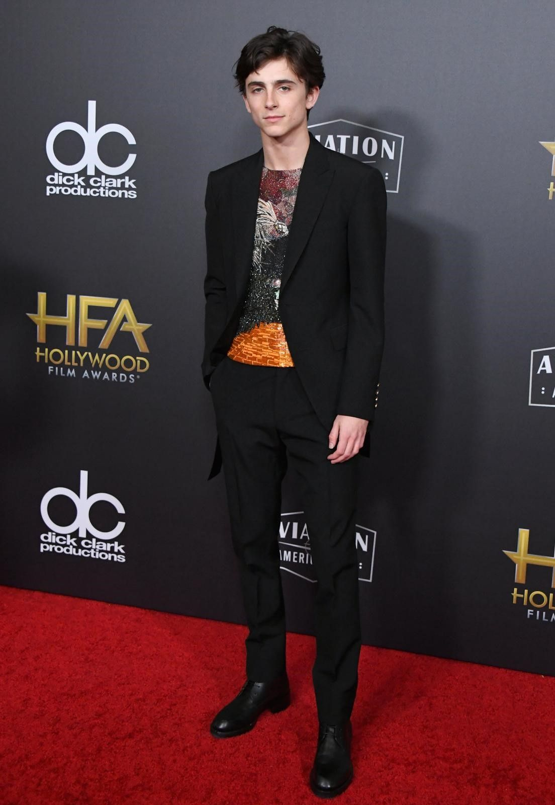 b51b5803d631fd Timothée Chalamet wearing a suit and embroidered from the Louis Vuitton  Spring Summer 2019 Collection by Virgil Abloh. At the Hollywood Film  Awards, ...