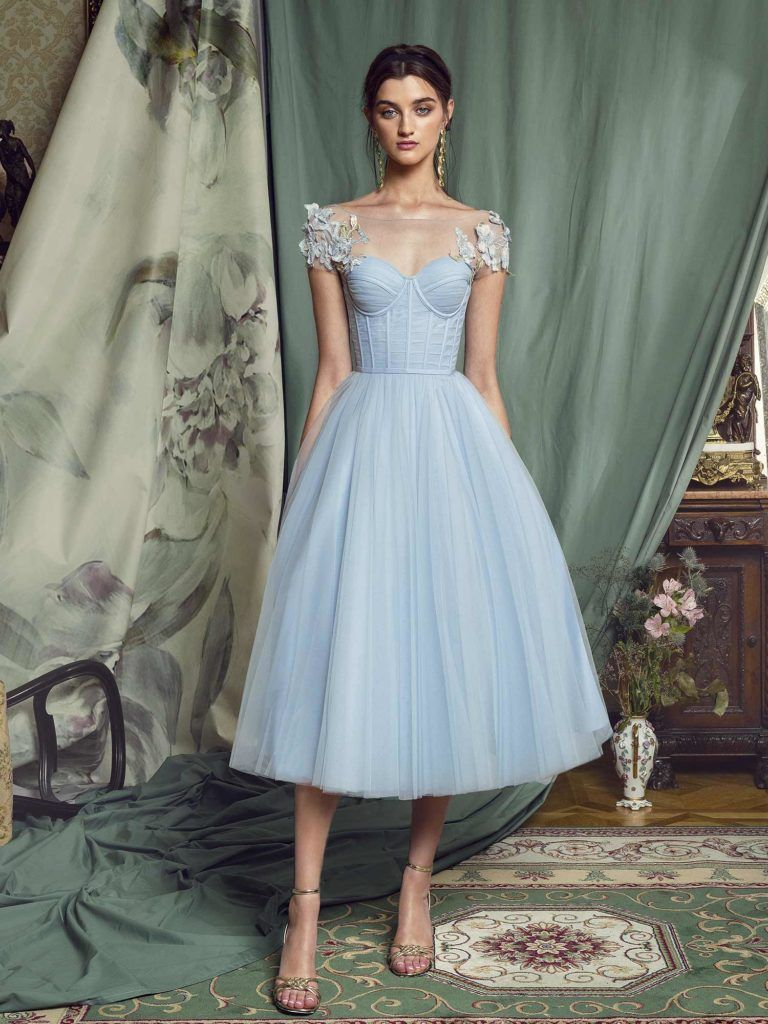 Style #481 is a beautifully delicate gown, with boning in the bodice, fun and full tulle skirt, and 3D floral appliqué on the shoulders.