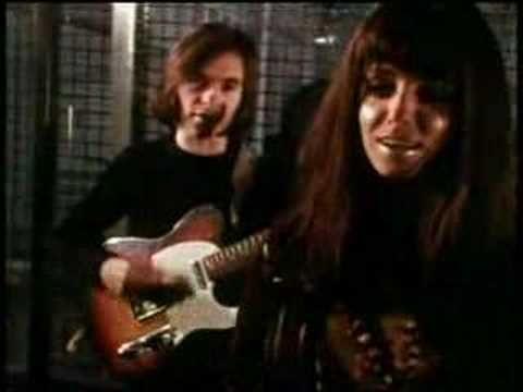 """Promo video: Shocking Blue performing """"Venus"""" in front of some caged monkeys.  Line-up: Robbie van Leeuwen (vocals, guitar), Mariska Veres (vocals), Klaasje van der Wal (bass guitar), and Cornelius van Beek (drums)."""