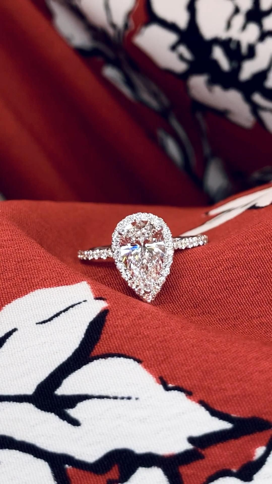 Selected with the same impeccable care as our natural diamonds, this pear shape lab created diamond engagement ring is the perfect one for her. Designed with a delicate diamond halo and band for a stunning look. By Ascot Diamonds.