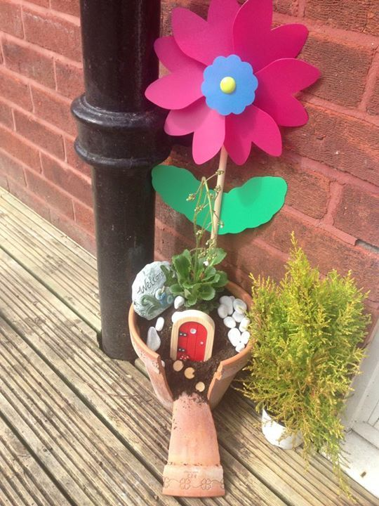 We could not resist posting this picture! How lucky is fairy Luke to have such a beautiful fairy garden for the Summer time? #Magic #FairyDoor