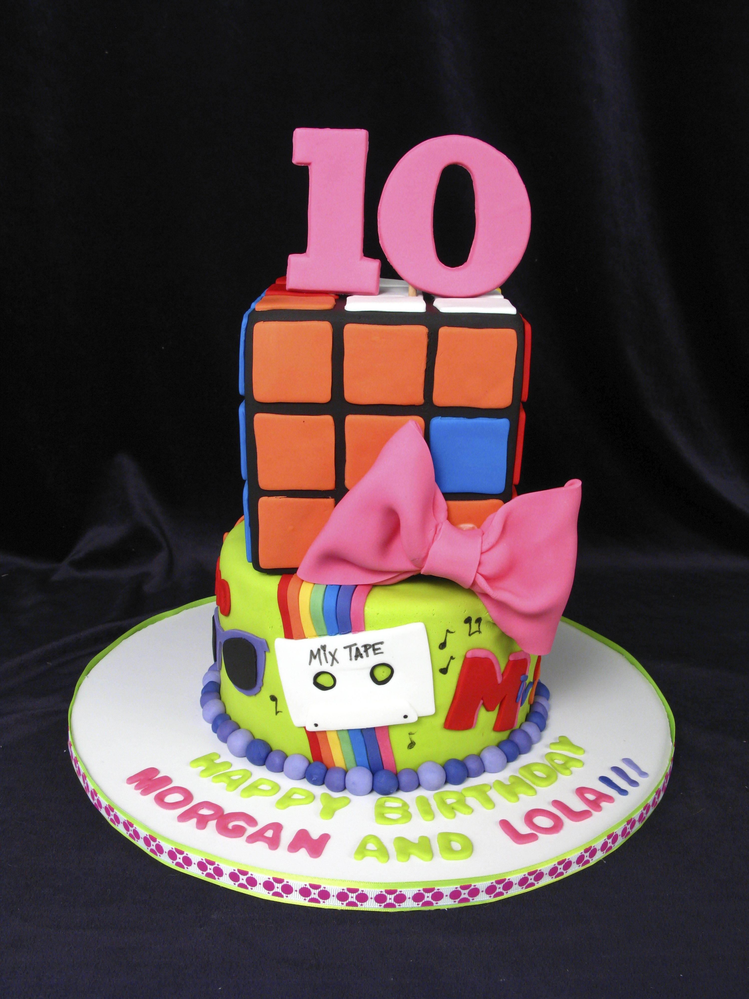 Fun 10th birthday cake Rubix cube bows mix tape rainbow fun
