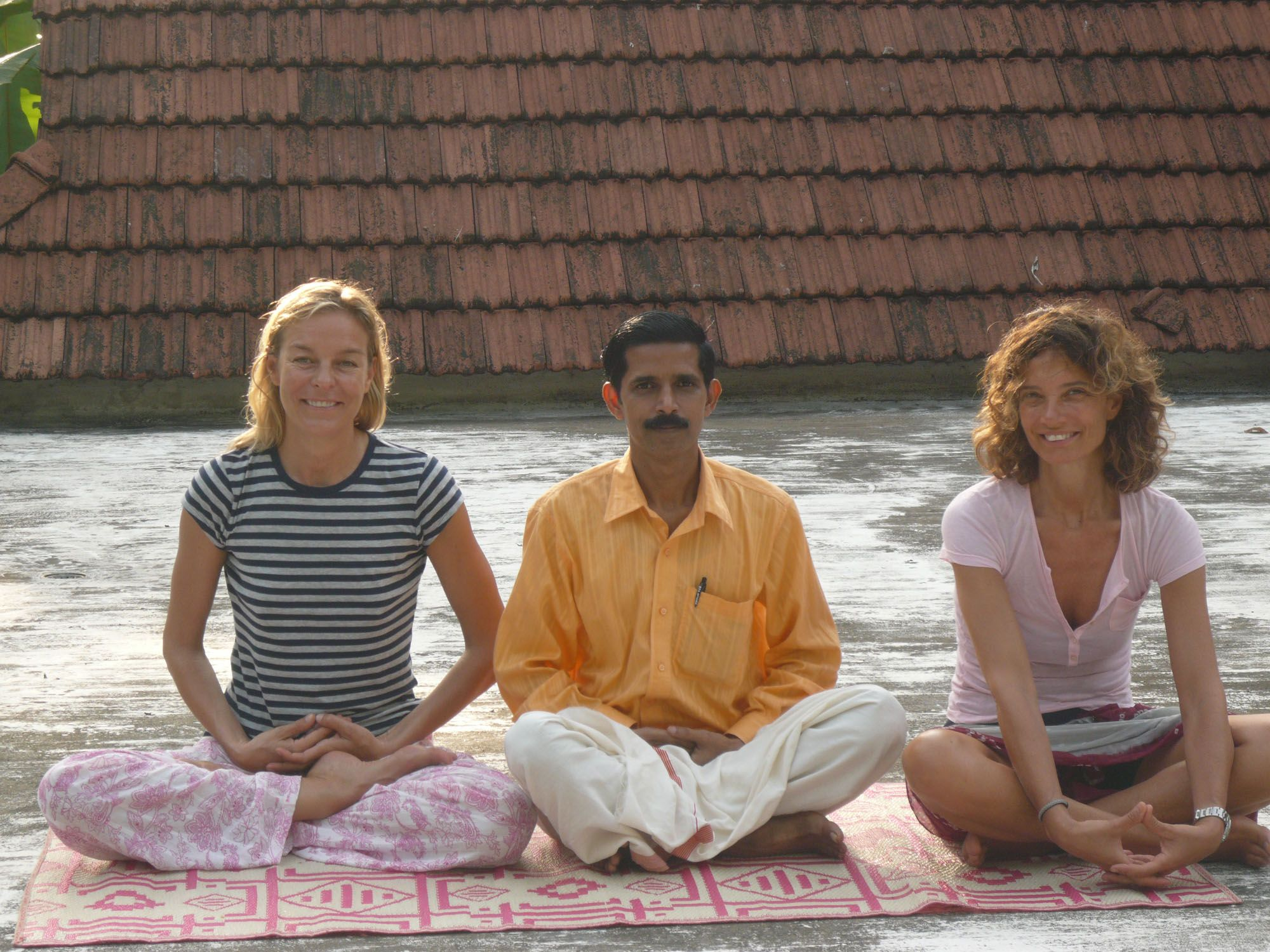 (Kerala) India. Alessandra, I and our yoga teacher Anto his guru