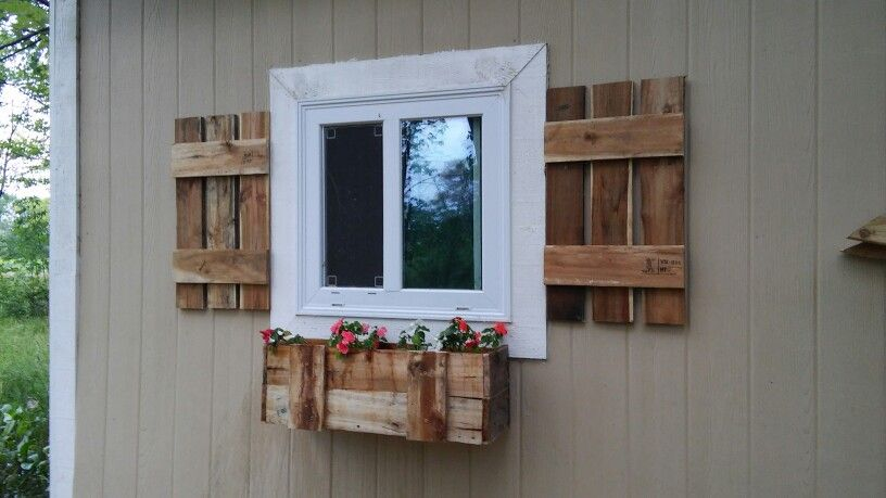 Pallet wood shutters and window box on the shed.   Wood ...