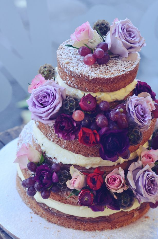 Gorgeous purples compliment the nakedness of this delicious cake.  Via: The Wedding Blog - Stylist Magazine