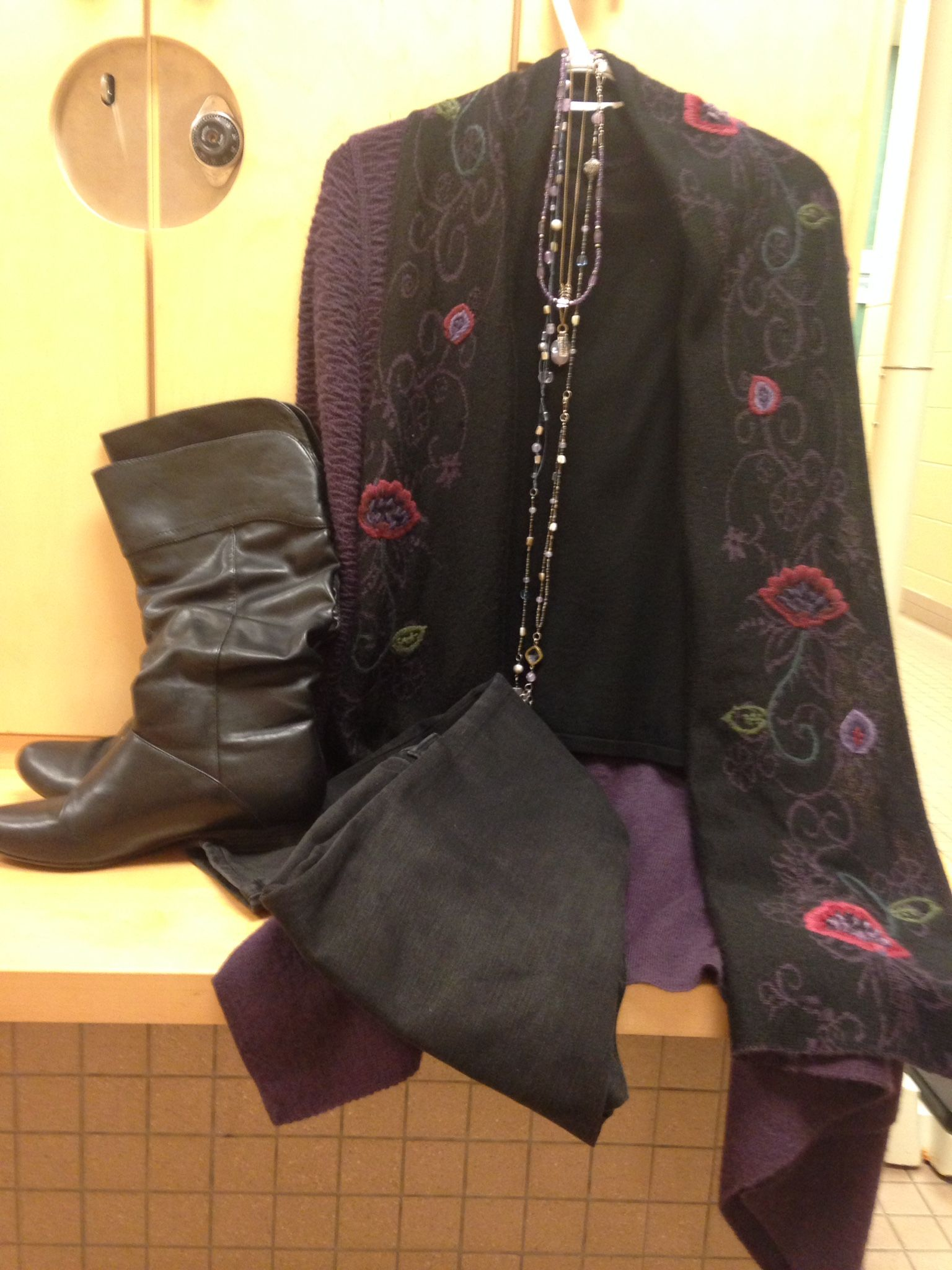 2016-01-08. Black mock turtleneck short sleeved sweater. Black jeans.  Purple alpaca sweater jacket.   Black leather boots.