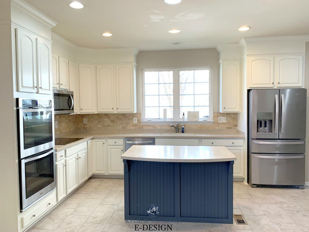 Benjamin Moore White Painted Oak Cabinets Beige Tile Floor Travertine Tile Backsplash Beige Counter In 2020 Beige Tile Floor Beige Tile Kitchen Floor Beige Kitchen