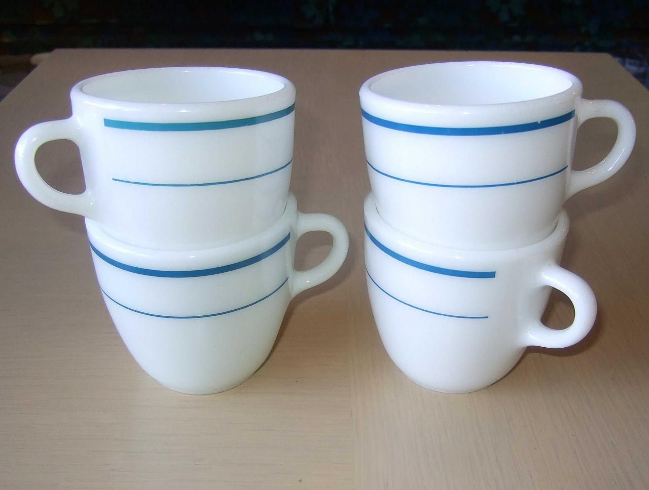 Set of four Pyrex milk glass coffee cups with dark turquoise-blue ...