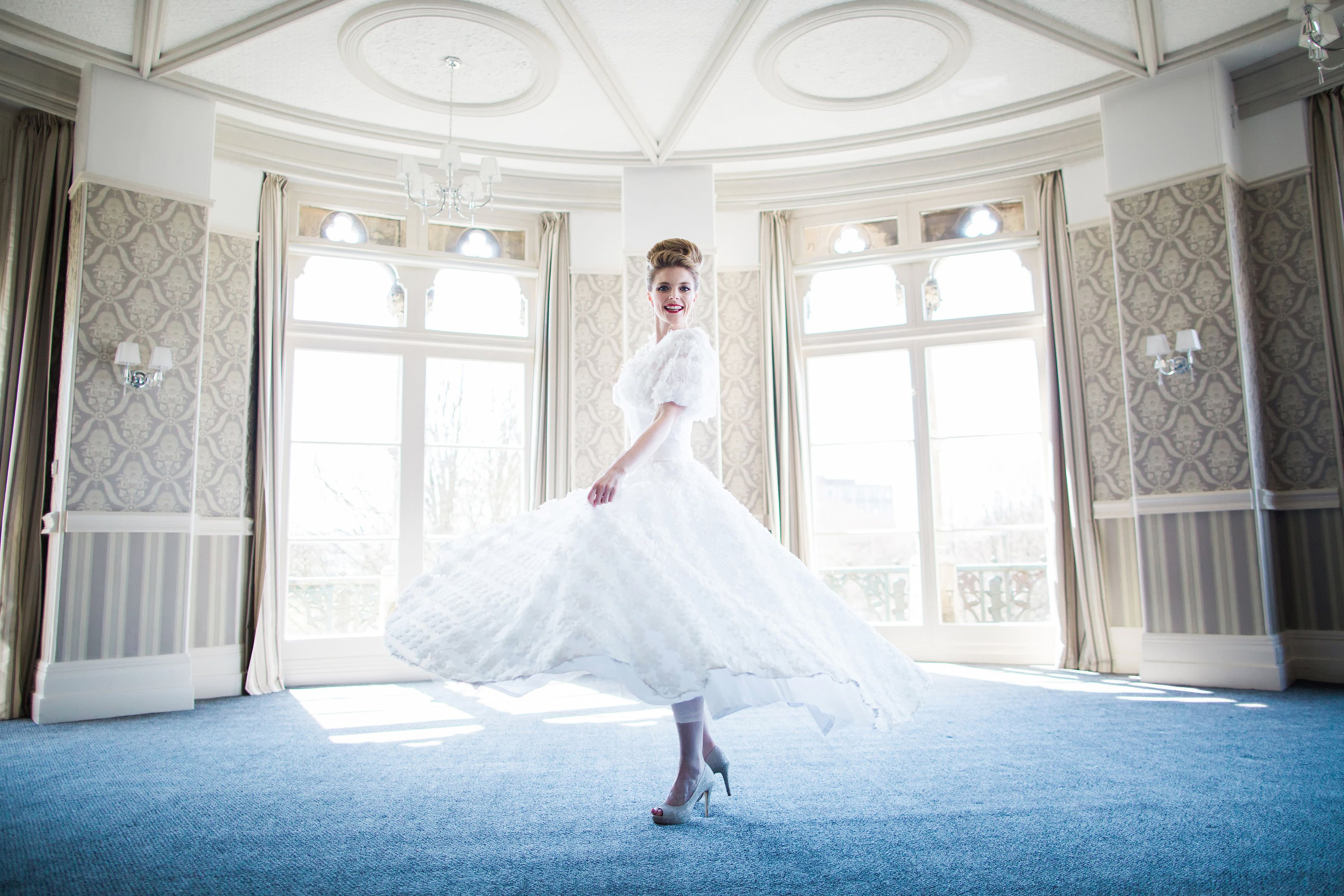 All in a spin, tea length wedding dress with full circle skirt and chic bolero, by Christine Trewinnard.