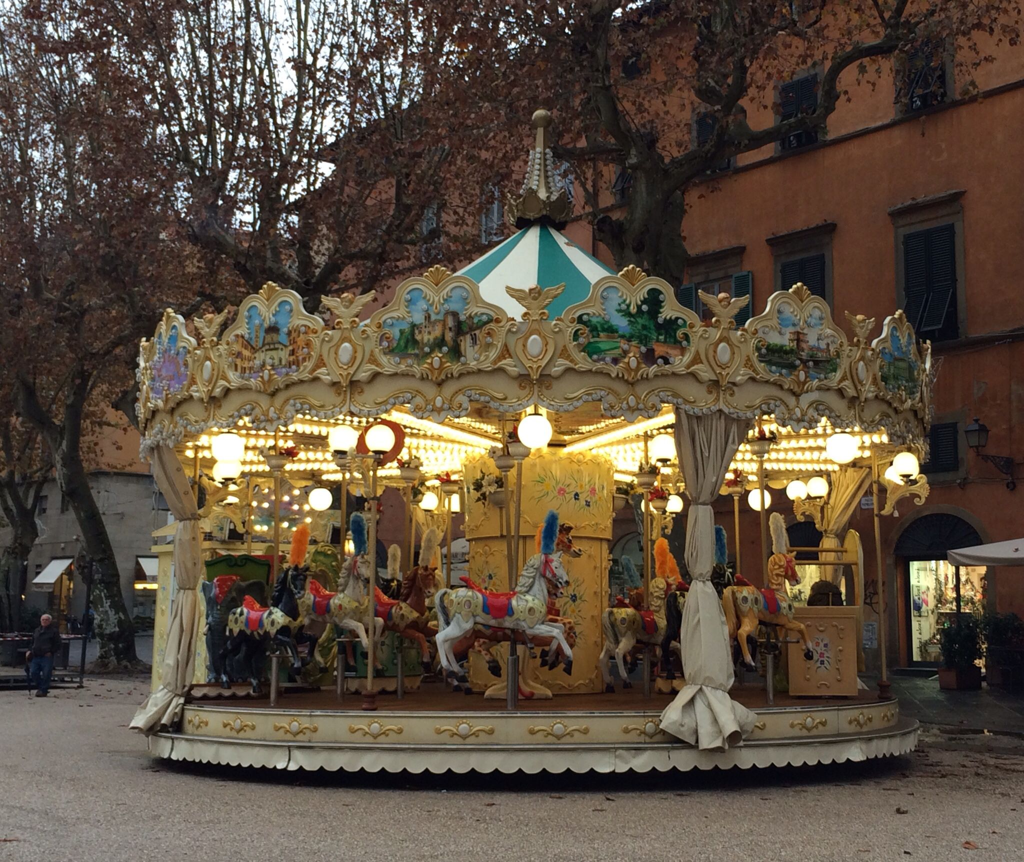 Carousel in Piazza Napoleone in Lucca, Italy. | Carousel horses ...