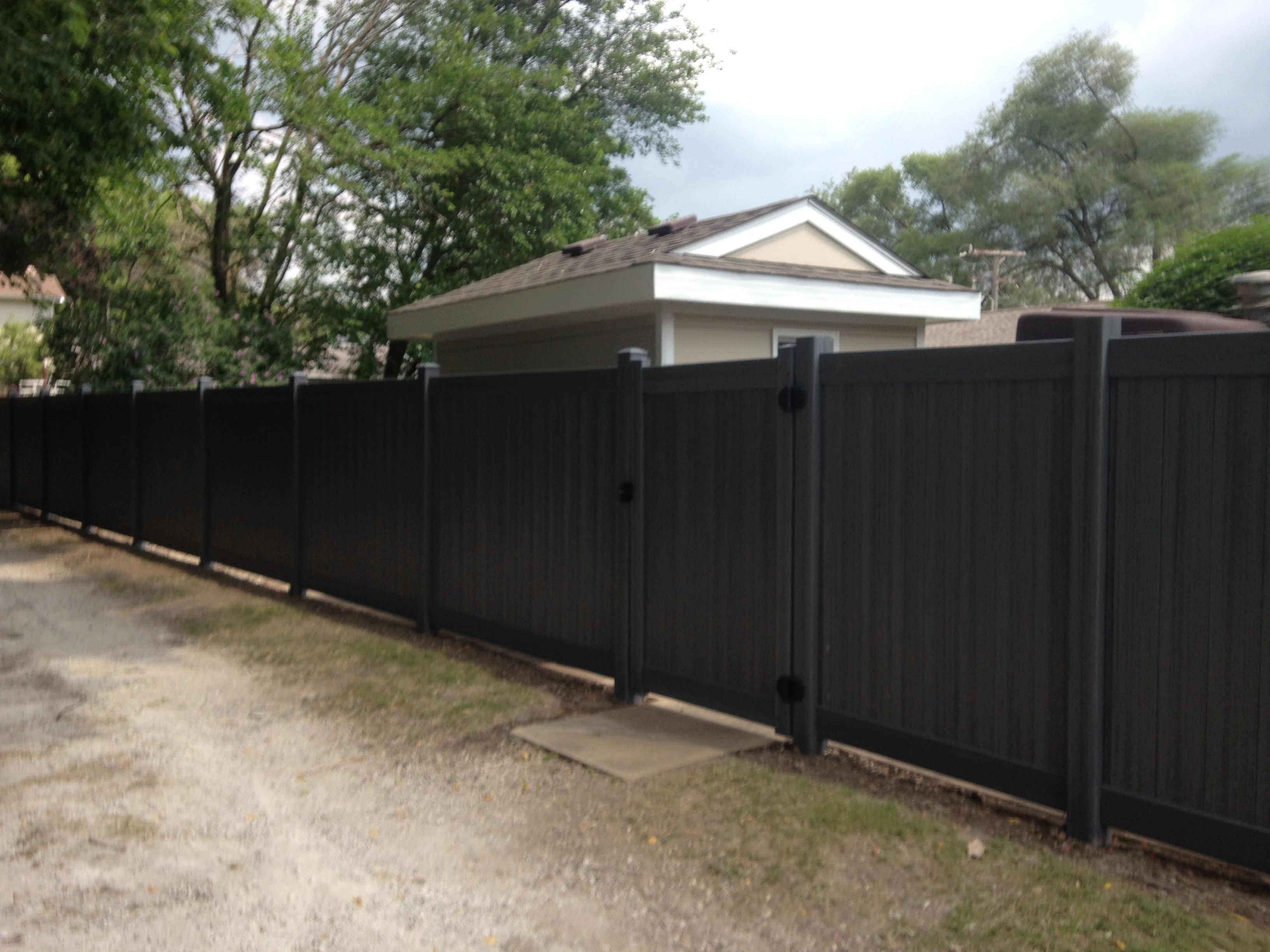 Barn wood grain gothic composite fence panel wpc fencing marchio fence company can install vinyl fences at your joliet il home or business learn more about this fencing material online or simply call us today baanklon Gallery