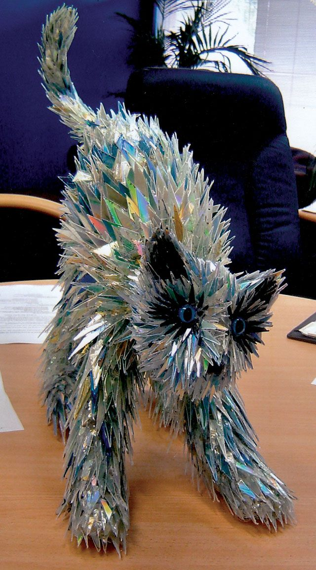 Australian artist sean avery creates beautiful animal sculptures out of recycled cd fragments