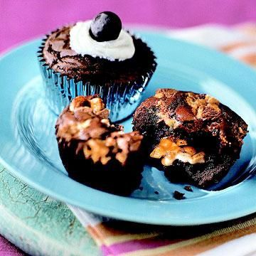 Tailgaters' Brownie Cupcakes with a surprise candy-bar center. Click here for more tailgating recipes: http://www.midwestliving.com/food/entertaining/tailgating-recipes/page/10/0