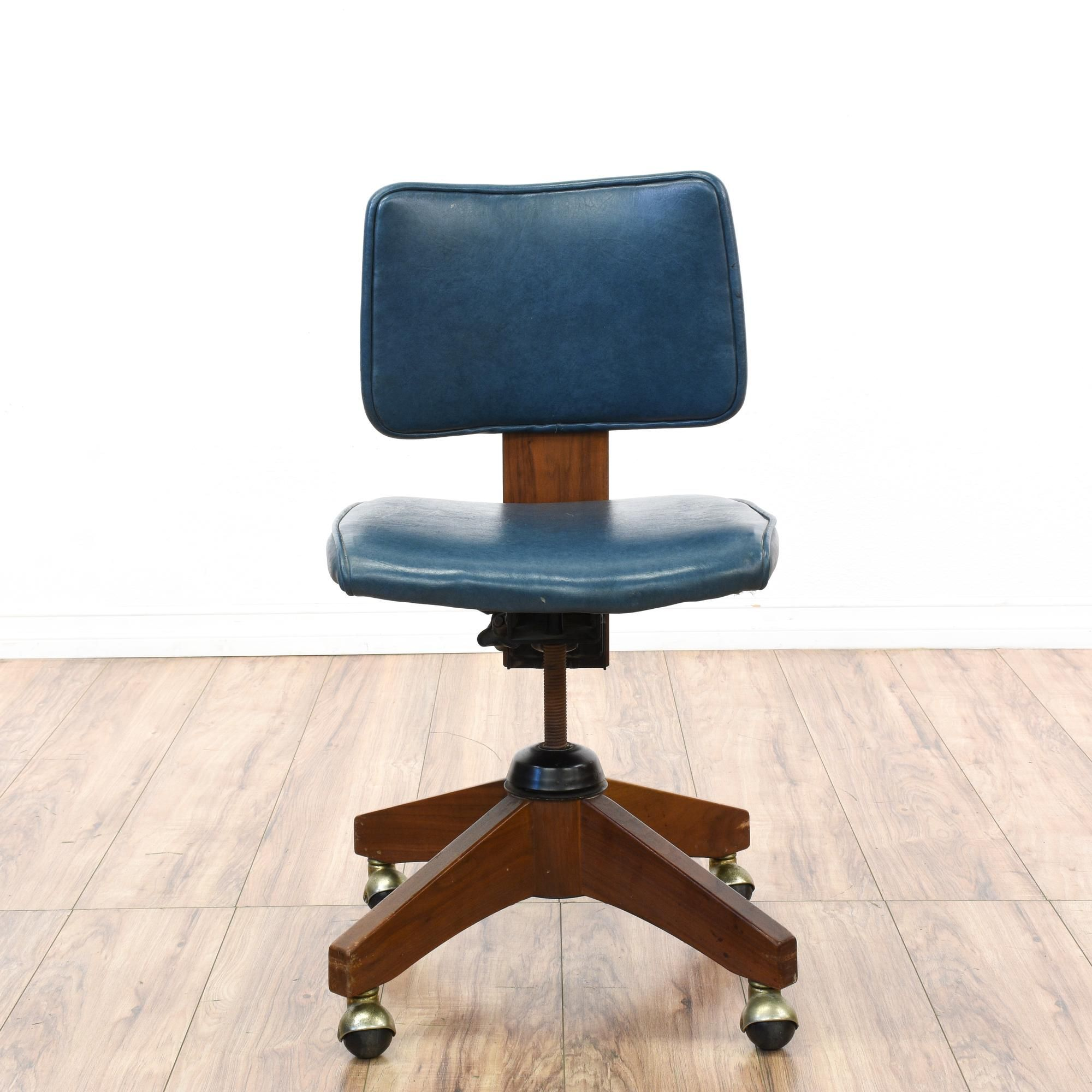 This retro office chair is featured in a solid wood with a glossy