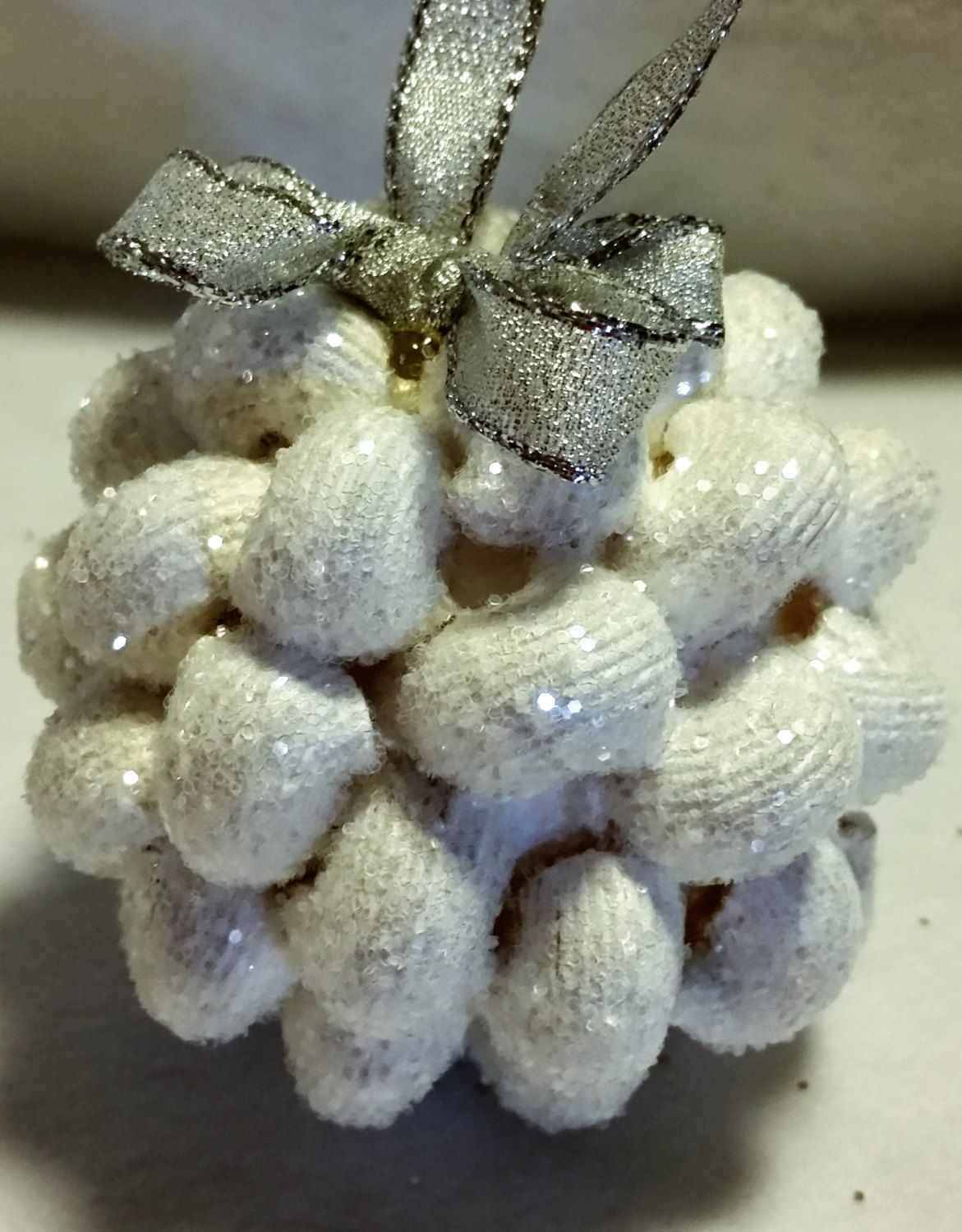 Textured glitter ornament with white undertone color and irridescent glitter and silver bow by JenniesCraftables on Etsy