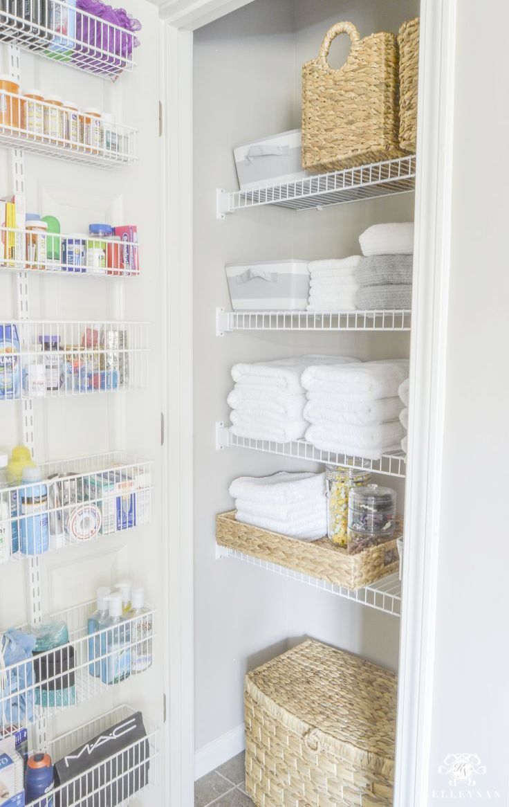 Attrayant Organized Bathroom Linen Closet Anyone Can Have   Elfa Door System With  Medicine Storage Solution