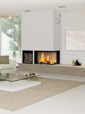 Le modèle : La cheminée d'angle est vitrée et ouverte sur trois de ses faces. Elle offre une meilleure vue sur le foyer. Le conseil en plus : Comme ici, le contraste entre la couleur du mur et ... #maisonAPart