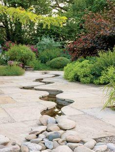 Stream in the garden - the sandstone was cut romantically winding stream. garden, sandstone, garden plants, garden furniture, interior garden, stream, pond