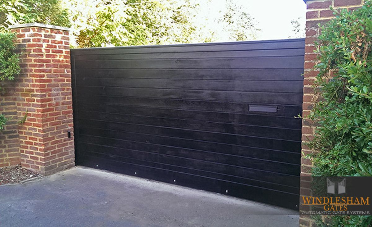 Black Sliding Wooden Gate With Integrated Letterbox Blackslidinggate Woodengate Blackgate Slidinggate Automatic Sliding Gate Sliding Gate Automatic Gate