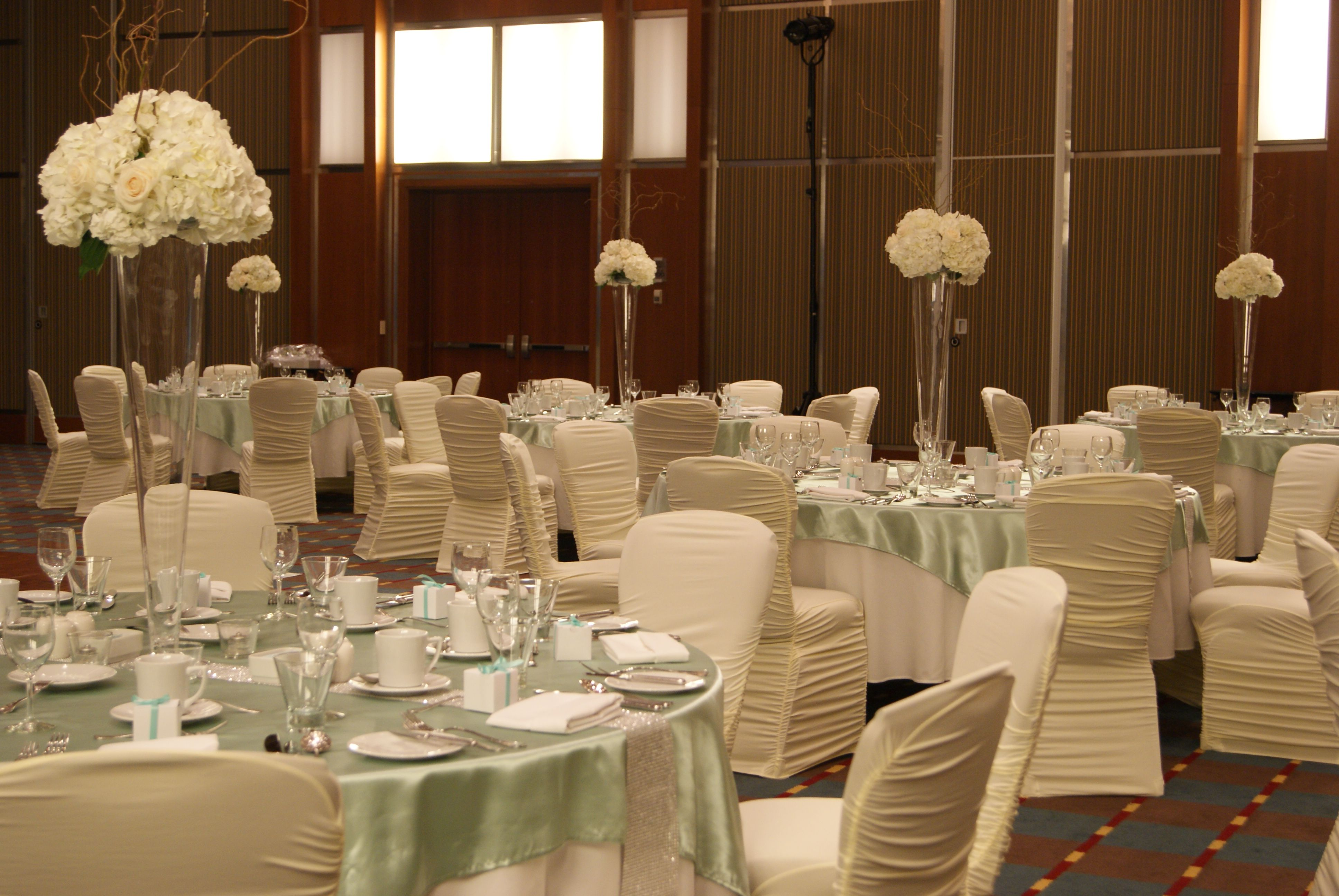 chair covers sage green mesh office uk table overlays with silver runners ivory spandex and fresh floral centerpieces brookstreet hotel kanata on