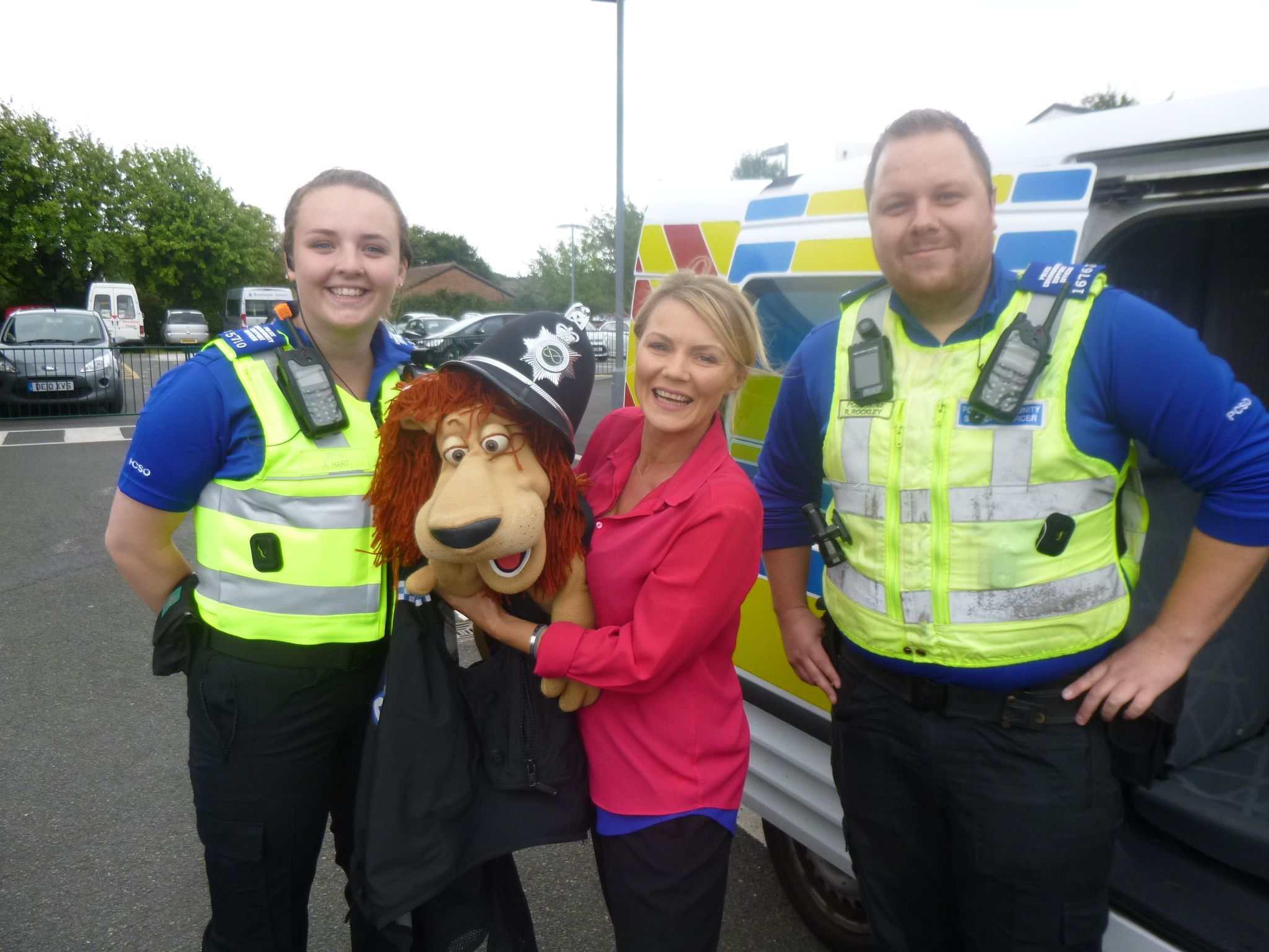 Brain the Lion tries on a police hat and jacket for size