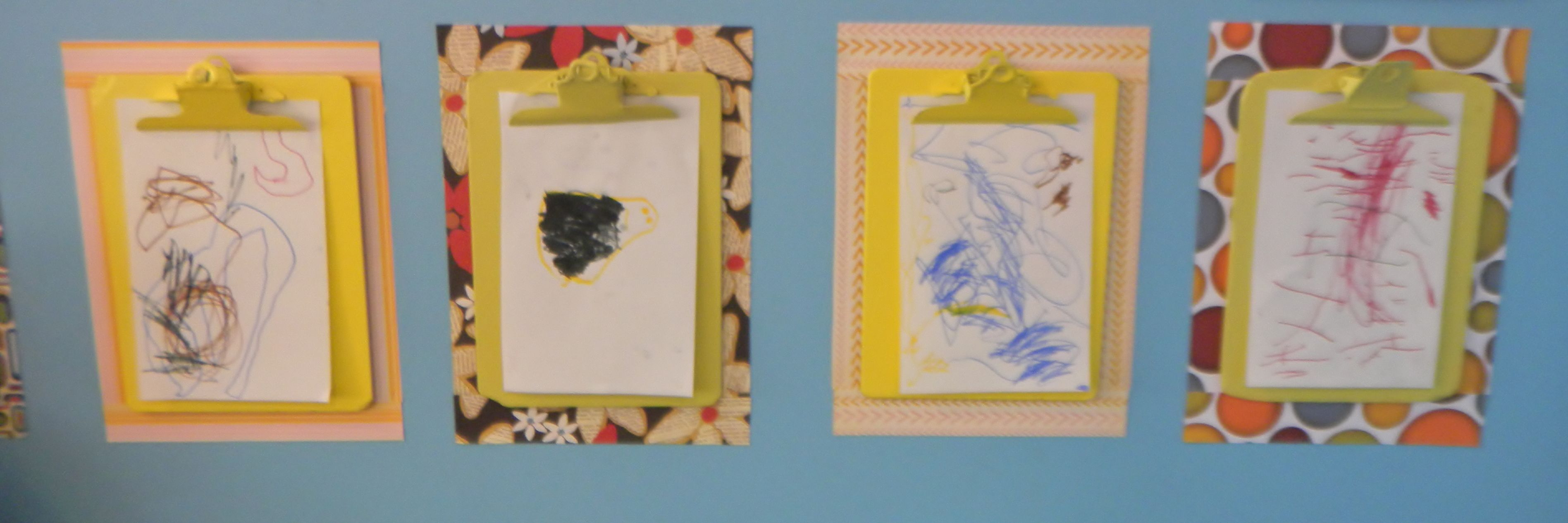 I spray painted old clipboards and hung them  up in the classroom so my children can hang up their own art work.