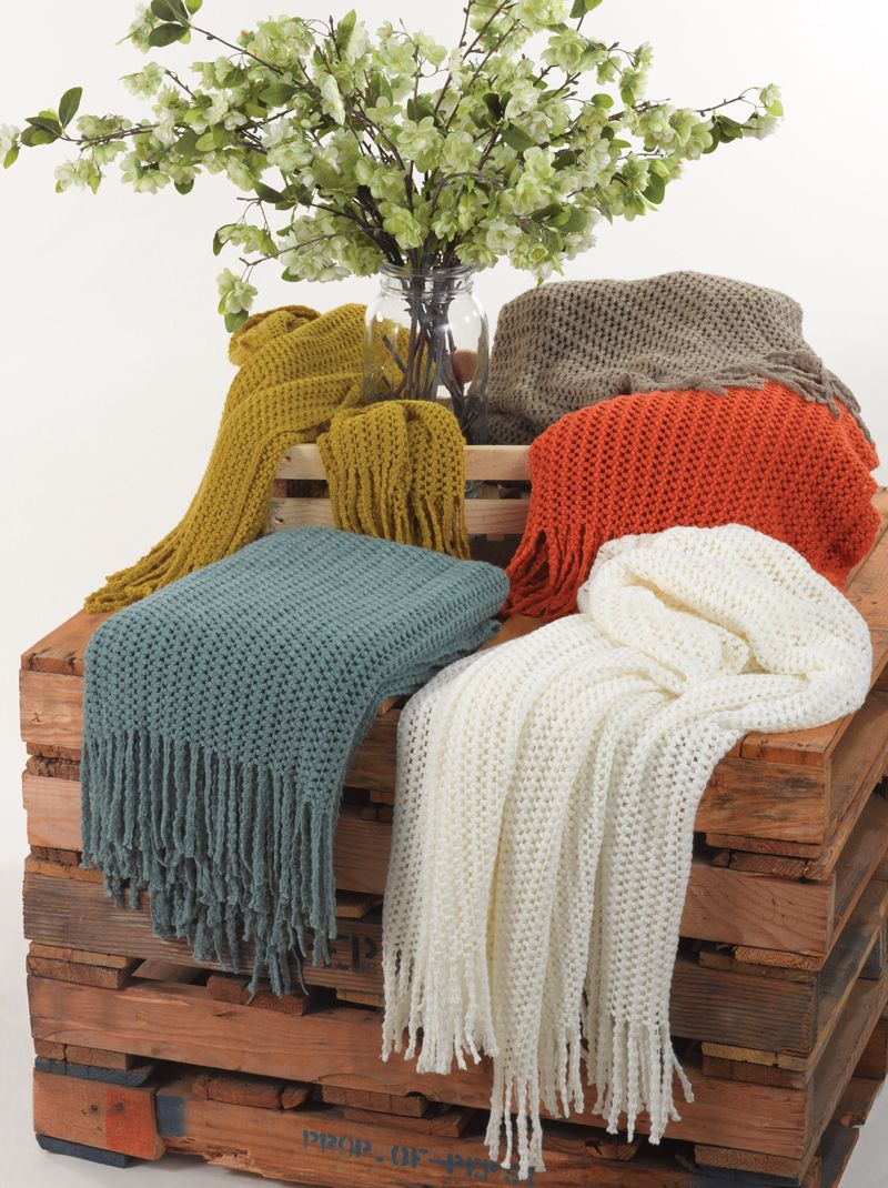Knitted design throws in chartreuse sea green vanilla persimmon
