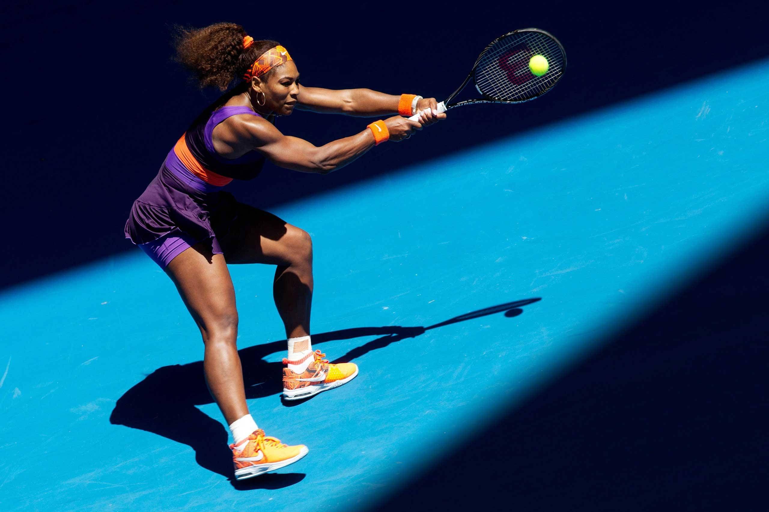 Serena Williams returns a shot against Ayumi Morita in the