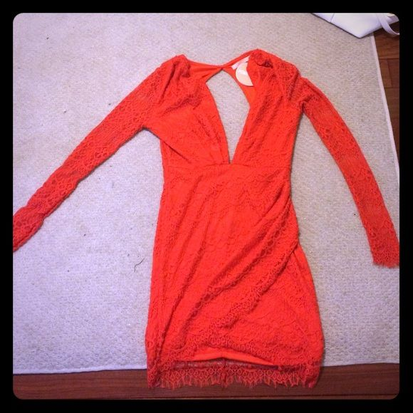 Red-orange lace Peppermayo dress red-orange lace dress with open back and plunging V neck front. Never worn, with tags. From Peppermayo, brand Paradisco. Size 8 -fits like a 4 S/M Peppermayo Dresses