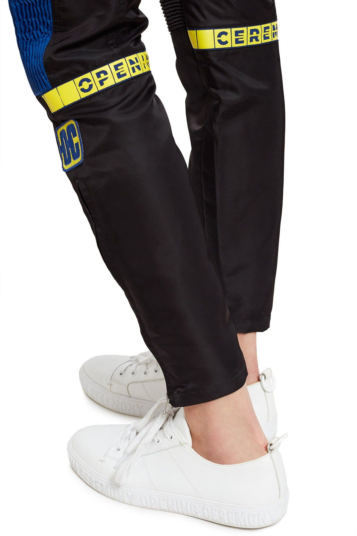 Opening Ceremony Moto Pant With Striking Logo Graphics And Bold Color Blocking Torch S Spring Summer 2018 Takes Insp Moto Pants Mens Outfits Opening Ceremony