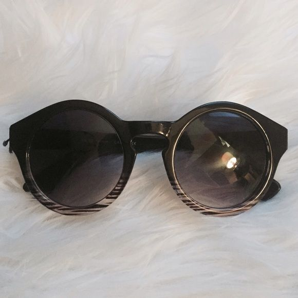 Round plastic sunglasses with striped detail Never worn ! Still have the original string from the tags attached (that's what's popping out in the photo) perfect condition. I think I bought these at BCBGeneration but I really don't remember. They are two tone with a clear zebra ombré on the bottom of the frame Accessories Sunglasses