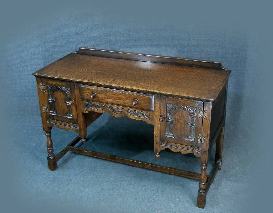 A lovely vintage carved oak kneehole desk in the Jacobean style with lots  of carved detail - A Lovely Vintage Carved Oak Kneehole Desk In The Jacobean Style With