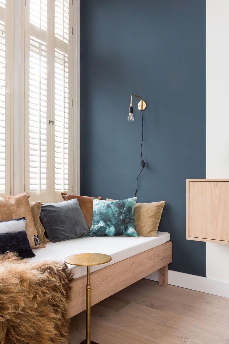 Interior home decor living room. Blue walls. Modern