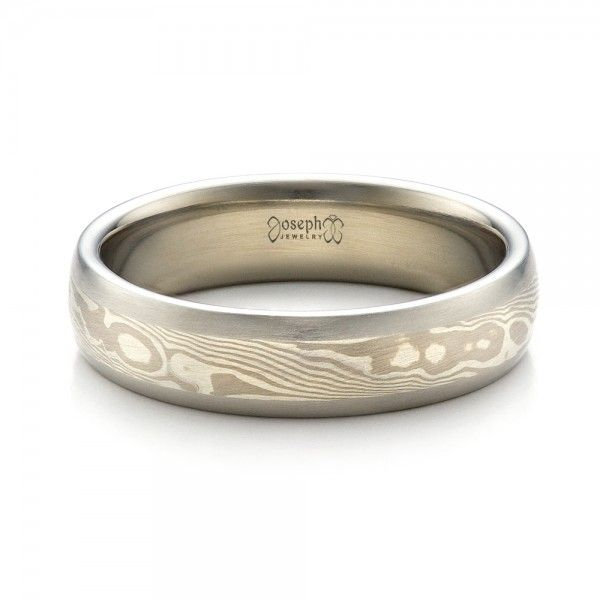1463 This Mens Wedding Band Features A Beautiful Mokume Pattern Made With White Gold And