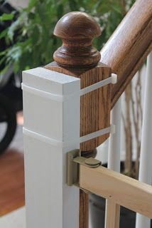 Need to install a baby gate, but don't want to drill into the wooden stair banisters??? Cut a couple of 2x4's to the height of the banister, paint,and secure with heavy zip ties. Then just add the baby gate hardware to the new piece of wood