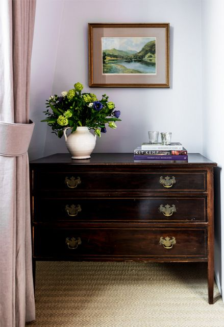 Pale lavender walls (Dulux Heritage Light French Gray) with an antique chest of drawers. The curtains are in a simple grey-lavender linen.