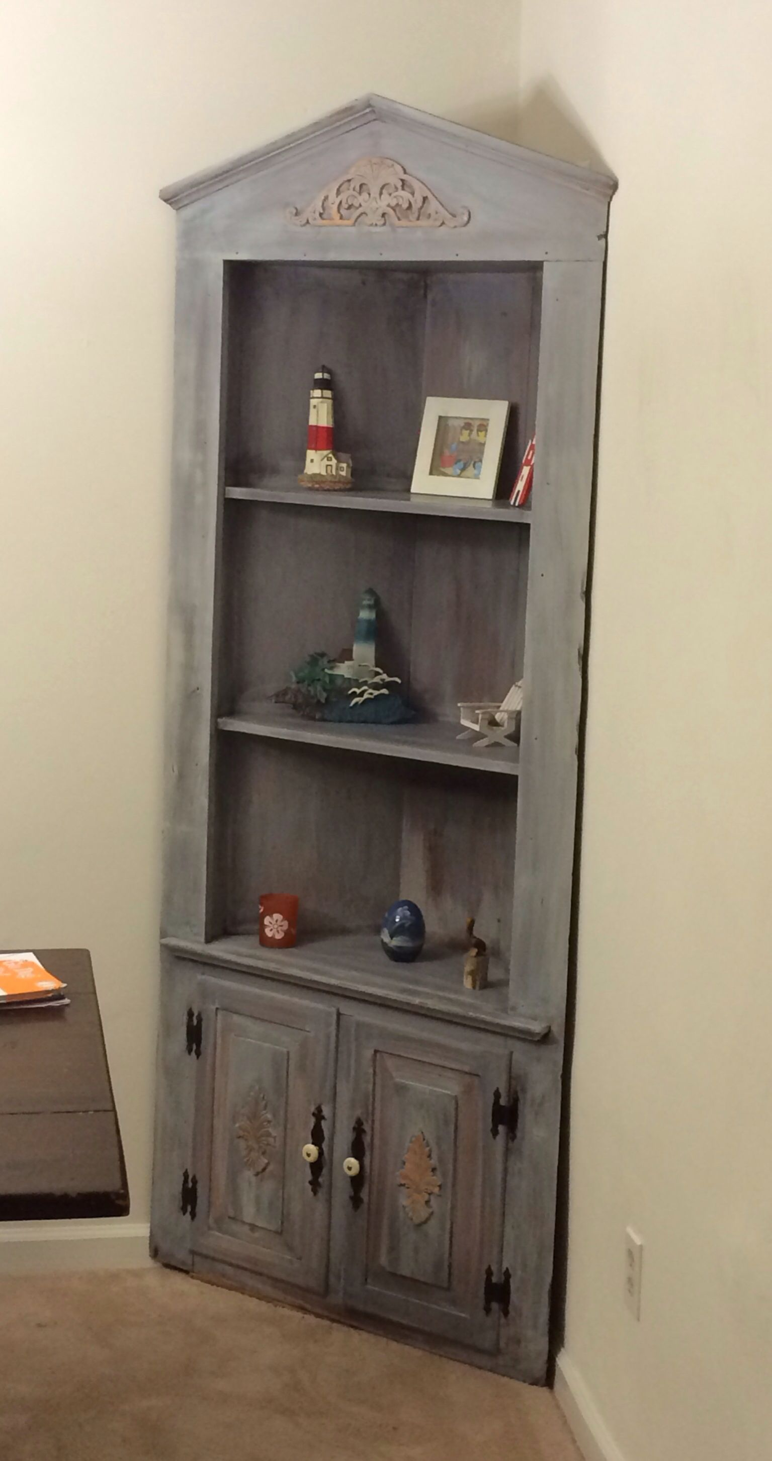 Corner curio cabinet that I redid with a new stain an white wash!