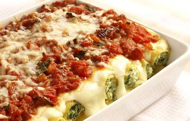 Spinach & Ricotta Cannelloni (Source: www.ocado.com )  Ingredients  10 cannelloni tubes or gluten free option: use 2 large eggplants and follow 2nd recipe below. olive oil 375 g frozen spinach, thawed and squeezed to remove excess liquid 250 g ricotta 2 tablespoons sour cream 1 garlic clove, crushed  Topping:  3 medium ripe tomatoes, finely chopped 1/3 cup flat leaf parsley 1/4 cup parmesan cheese, shredded  Directions  Combine spinach, ricotta, sour cream and garlic in a medium ...