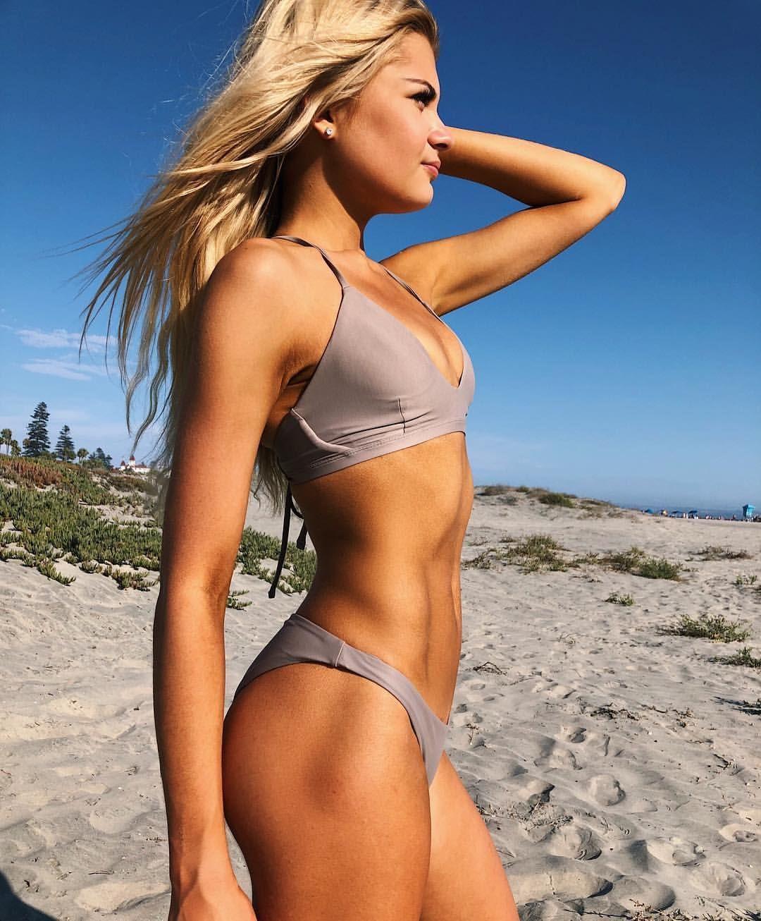 Danielle lloyd shows off tight bikini body in pool changing room selfie