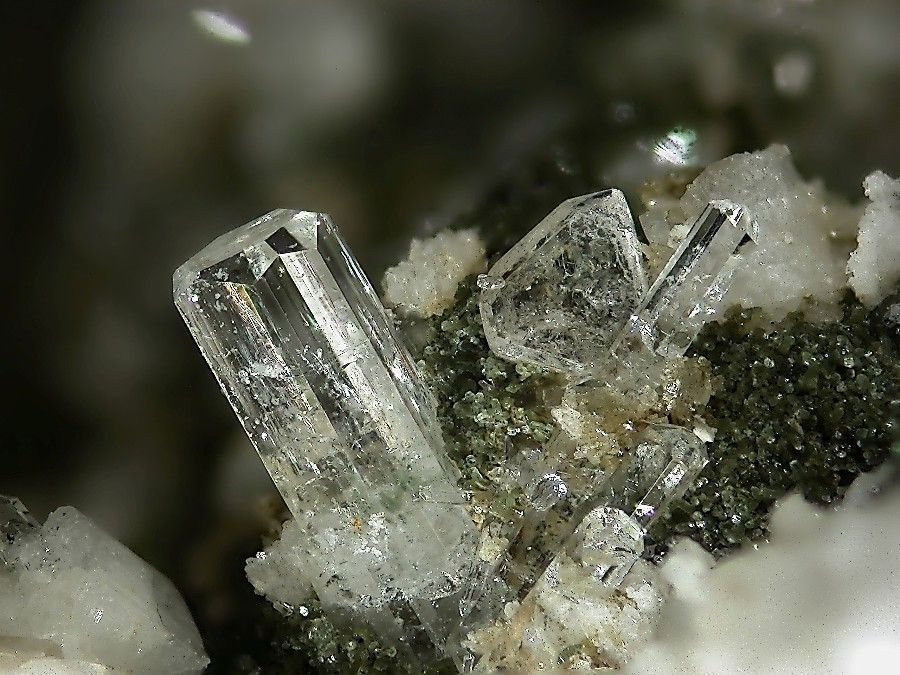 Milarite,  K2Ca4Al2Be4Si24O60•(H2O) , Schijenstock, Uri, Switzerland. Fov 5 mm. Copyright: Stephan Wolfsried